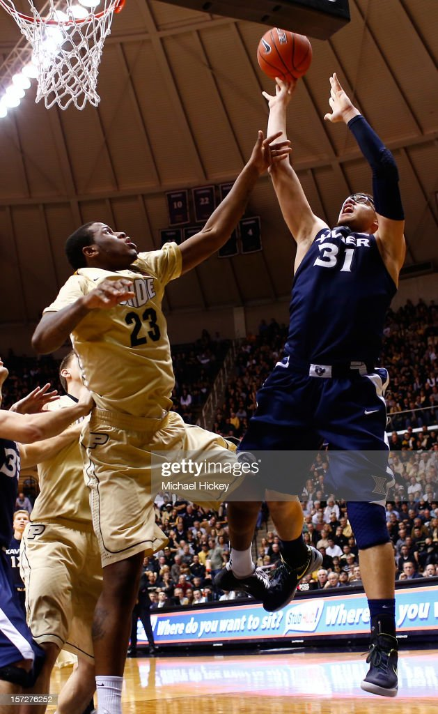 Isaiah Philmore #31 of the Xavier Musketeers shoots the ball against <a gi-track='captionPersonalityLinkClicked' href=/galleries/search?phrase=Jay+Simpson&family=editorial&specificpeople=4174329 ng-click='$event.stopPropagation()'>Jay Simpson</a> #23 of the Purdue Boilermakers at Mackey Arena on December 1, 2012 in West Lafayette, Indiana. Xavier defeated Purdue 63-57.