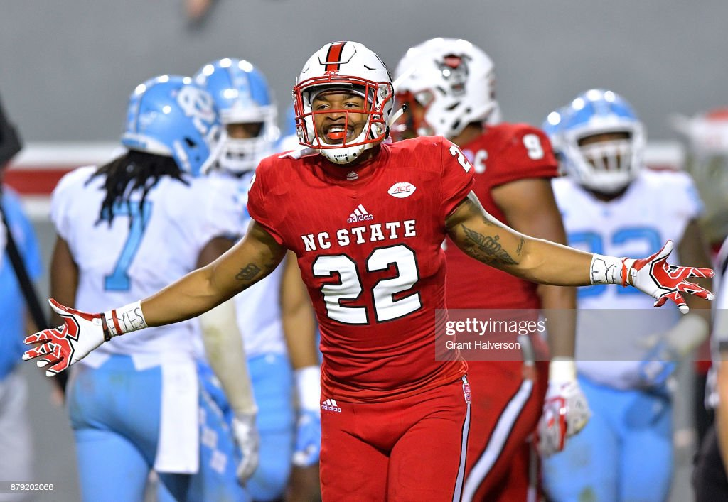 Isaiah Stallings #22 of the North Carolina State Wolfpack reacts after their win against the North Carolina Tar Heels at Carter Finley Stadium on November 25, 2017 in Raleigh, North Carolina. North Carolina State won 33-21.