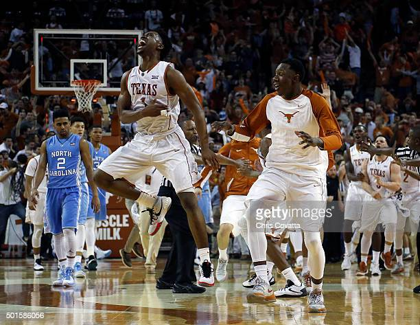 Isaiah Taylor and Tevin Mack of the Texas Longhorns celebrate after defeating the North Carolina Tar Heels at the Frank Erwin Center on December 12...