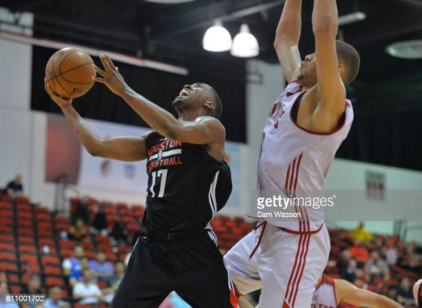 Isaiah Taylor of the Houston Rockets drives against Edy Tavares of the Cleveland Cavaliers during the 2017 Summer League at the Cox Pavilion on July...