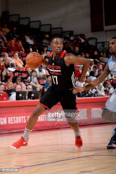 Isaiah Taylor of the Houston Rockets handles the ball during the game against the Denver Nuggets during the 2017 Las Vegas Summer League on July 7...