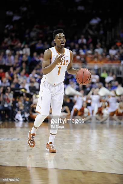 Isaiah Taylor of the Texas Longhorns controls the ball against the Texas Tech Red Raiders during the first round of the Big 12 basketball tournament...