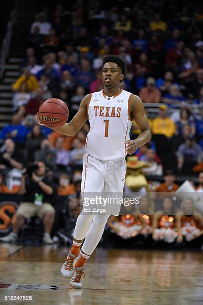 Isaiah Taylor of the Texas Longhorns controls the ball against the Baylor Bears during the quarterfinals of the Big 12 Basketball Tournament at...