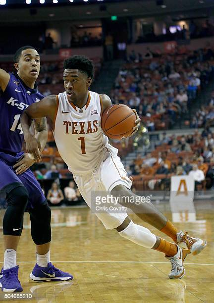 Isaiah Taylor of the Texas Longhorns drives against Justin Edwards of the Kansas State Wildcats at the Frank Erwin Center on January 5 2016 in Austin...