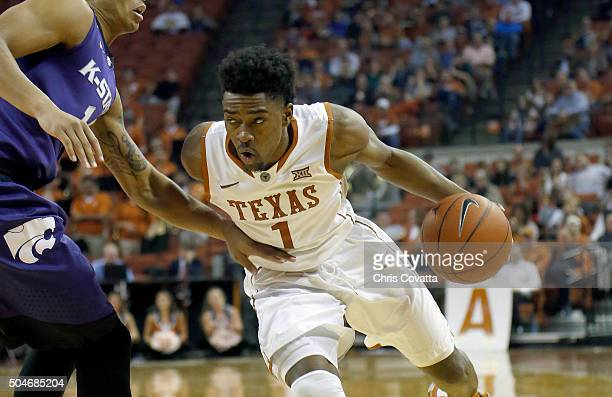 Isaiah Taylor of the Texas Longhorns drives against the Kansas State Wildcats at the Frank Erwin Center on January 5 2016 in Austin Texas