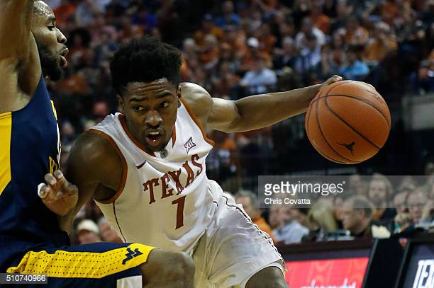 Isaiah Taylor of the Texas Longhorns drives around Tarik Phillip of the West Virginia Mountaineers at the Frank Erwin Center on February 16 2016 in...