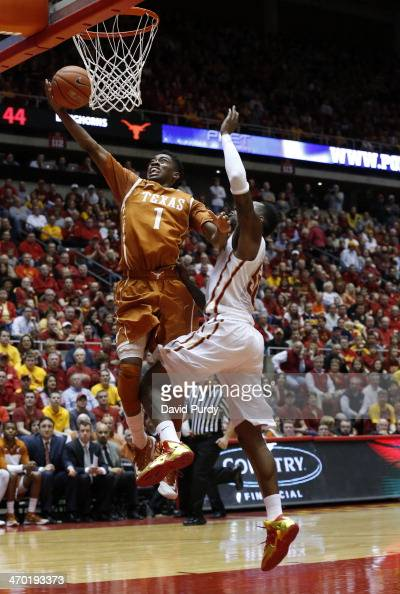 Isaiah Taylor of the Texas Longhorns lays up a shot as DeAndre Kane of the Iowa State Cyclones defends in the second half of play at Hilton Coliseum...