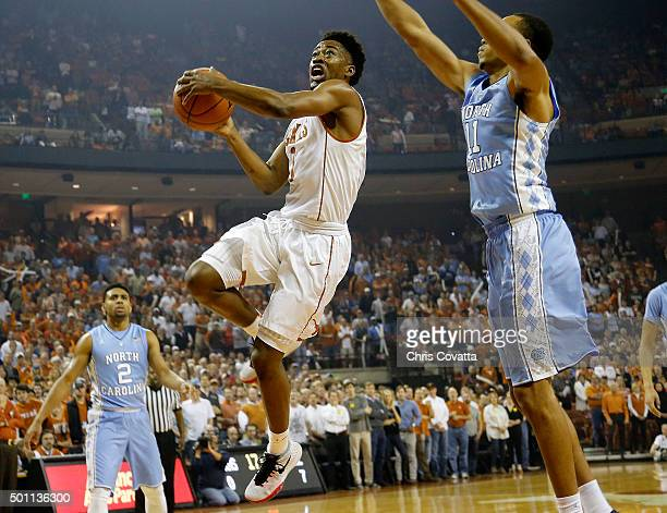 Isaiah Taylor of the Texas Longhorns leaps to the basket against Brice Johnson of the North Carolina Tar Heels at the Frank Erwin Center on December...