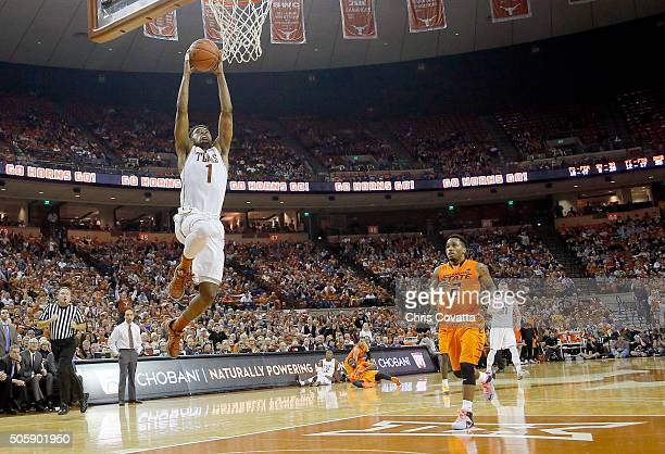 Isaiah Taylor of the Texas Longhorns leaps to the basket against the Oklahoma State Cowboys at the Frank Erwin Center on January 16 2016 in Austin...