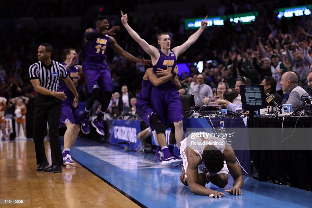 Isaiah Taylor of the Texas Longhorns reacts after Paul Jesperson of the Northern Iowa Panthers hit a half court three pointer to win the game with a...