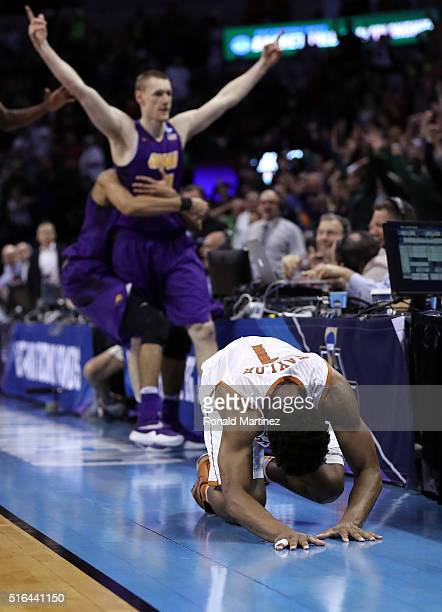 Isaiah Taylor of the Texas Longhorns reacts after Paul Jesperson of the Northern Iowa Panthers hit a half court three pointer at the buzzer to win...
