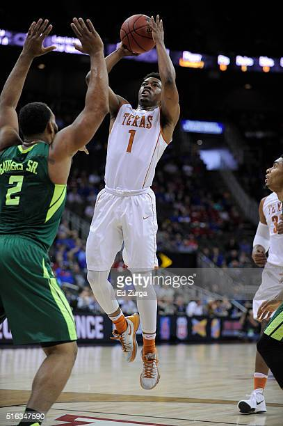 Isaiah Taylor of the Texas Longhorns shoots against Rico Gathers of the Baylor Bears during the quarterfinals of the Big 12 Basketball Tournament at...