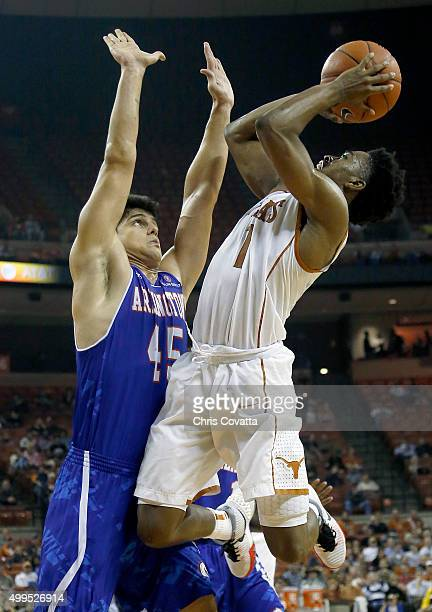Isaiah Taylor of the Texas Longhorns shoots over Jorge Bilbao of the TexasArlington Mavericks at the Frank Erwin Center on December 1 2015 in Austin...