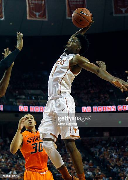 Isaiah Taylor of the Texas Longhorns shoots the ball against the Oklahoma State Cowboys at the Frank Erwin Center on January 16 2016 in Austin Texas