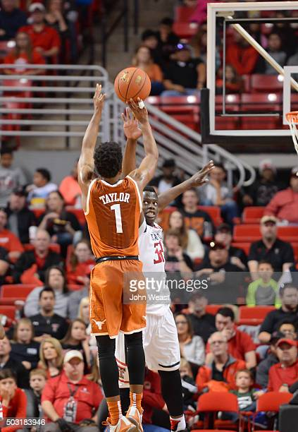 Isaiah Taylor of the Texas Longhorns shoots the ball over Norense Odiase of the Texas Tech Red Raiders during the game on January 02 2016 at United...