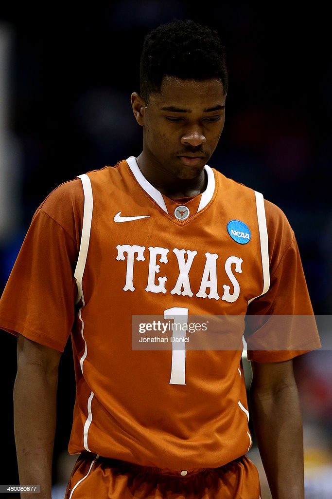 Isaiah Taylor of the Texas Longhorns walks off court after being defeated by the Michigan Wolverines during the third round of the 2014 NCAA Men's...