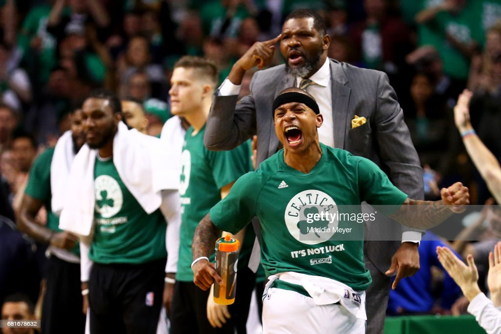 Isaiah Thomas #4 and assistant coach Walter McCarty of the Boston Celtics react after Avery Bradley #0 scored against the Washington Wizards during the first quarter of Game Five of the Eastern Conference Semifinals at TD Garden on May 10, 2017 in Boston, Massachusetts.