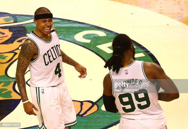 Isaiah Thomas and Jae Crowder of the Boston Celtics react after their 115105 win against the Washington Wizards during Game Seven of the NBA Eastern...