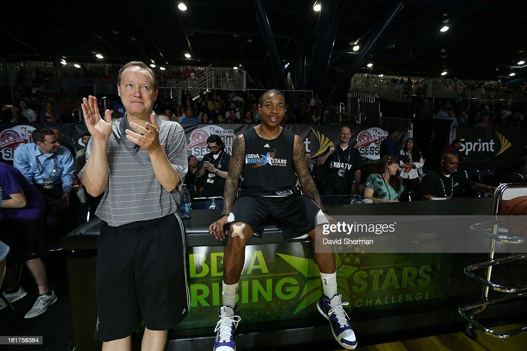 Isaiah Thomas and Mike Budenholzer Coach of Team Chuck react to a play during the BBVA Rising Stars Challenge Practice in Sprint Arena during the 2013 NBA Jam Session on February 15, 2013 at the George R. Brown Convention Center in Houston, Texas.