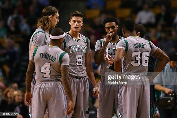 Isaiah Thomas Kelly Olynyk Jonas Jerebko James Young and Marcus Smart talk with Brad Stevens of the Boston Celtics during the game against the Utah...