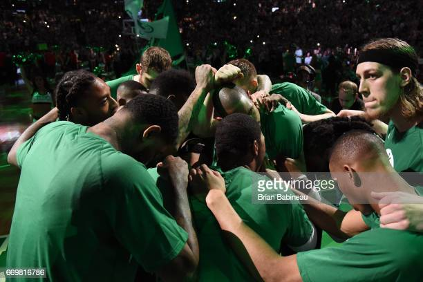 Isaiah Thomas of the Boston Celtics and his teammates huddle up around him before the Eastern Conference Quarterfinals game against the Chicago Bulls...