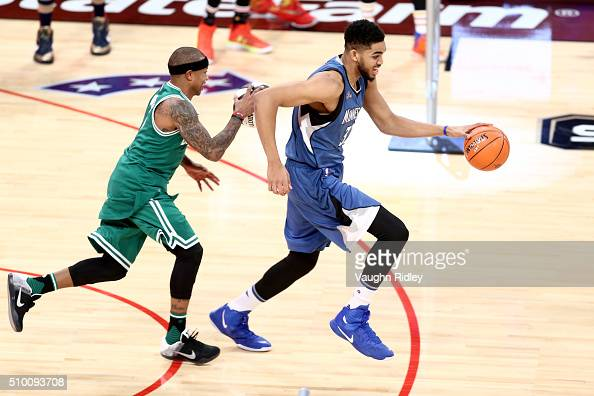 Isaiah Thomas of the Boston Celtics and KarlAnthony Towns of the Minnesota Timberwolves dribble in the Taco Bell Skills Challenge during NBA AllStar...