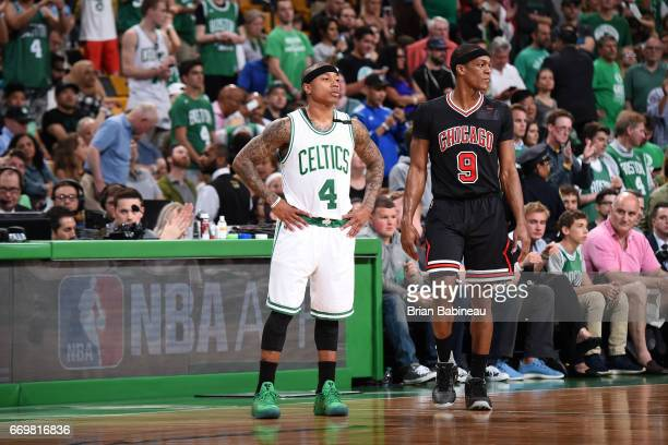 Isaiah Thomas of the Boston Celtics and Rajon Rondo of the Chicago Bulls stand on the court during the Eastern Conference Quarterfinals game during...