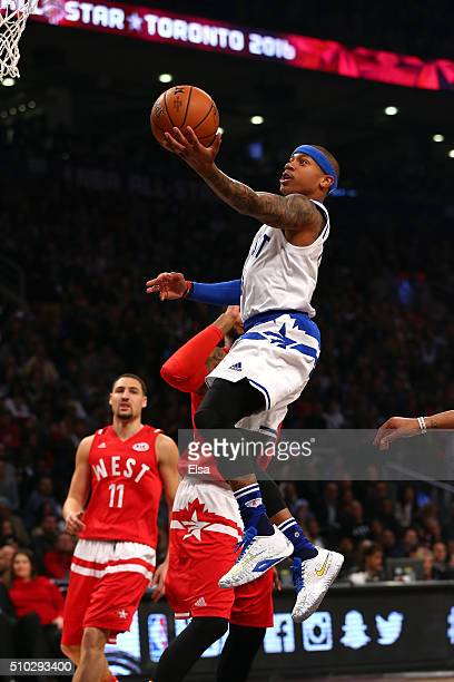Isaiah Thomas of the Boston Celtics and the Eastern Conference drives to the basket in the first half against the Western Conference during the NBA...