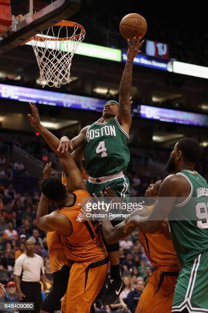 Isaiah Thomas of the Boston Celtics attempts a lay up over Alan Williams of the Phoenix Suns during the second half of the NBA game at Talking Stick...