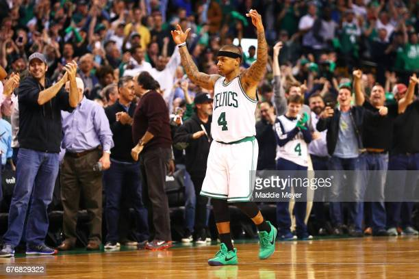 Isaiah Thomas of the Boston Celtics celebrates at the end the Celtics 129119 overtime win over the Wizards in Game Two of the Eastern Conference...