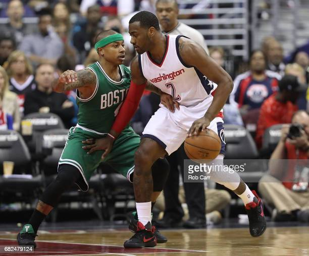 Isaiah Thomas of the Boston Celtics defends against John Wall of the Washington Wizards during Game Six of the NBA Eastern Conference SemiFinals at...