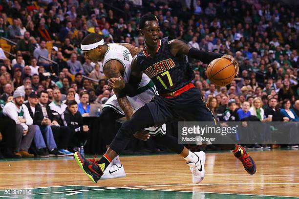 Isaiah Thomas of the Boston Celtics defends Dennis Schroder of the Atlanta Hawks during the fourth quarter at TD Garden on December 18 2015 in Boston...