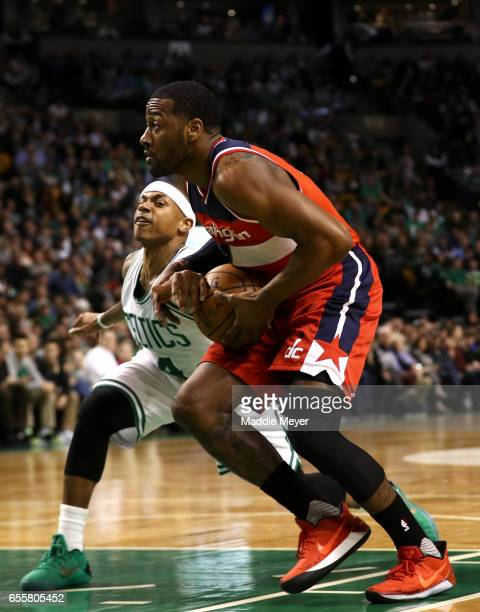 Isaiah Thomas of the Boston Celtics defends John Wall of the Washington Wizards during the second quarter at TD Garden on March 20 2017 in Boston...