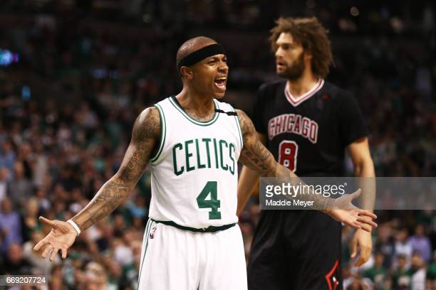 Isaiah Thomas of the Boston Celtics disputes a call against Amir Johnson during the first quarter of Game One of the Eastern Conference Quarterfinals...