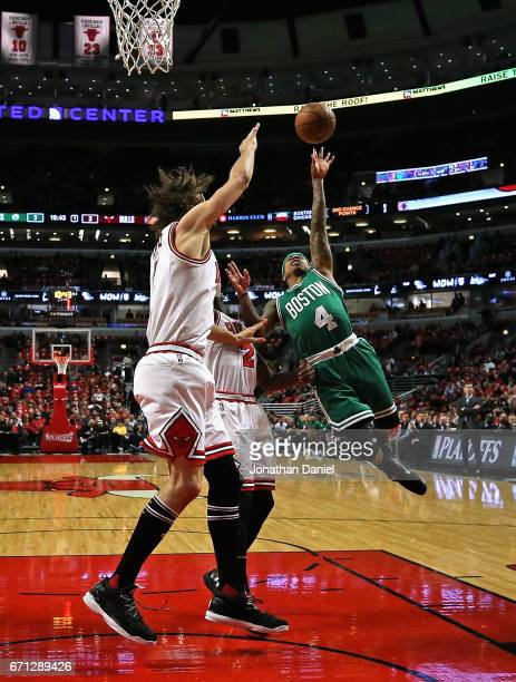 Isaiah Thomas of the Boston Celtics drives against Jerian Grant and Robin Lopez of the Chicago Bulls during Game Three of the Eastern Conference...