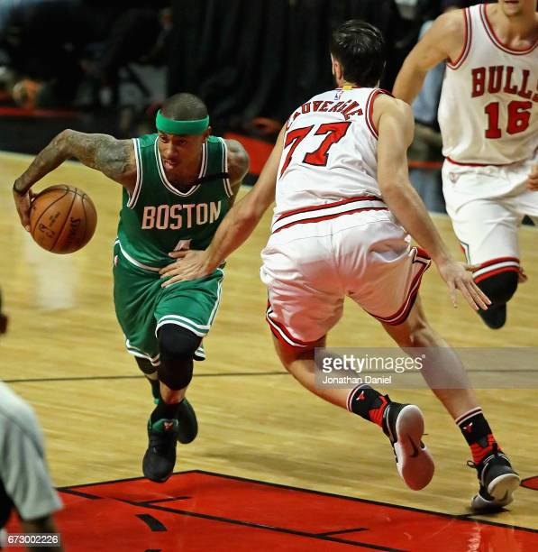 Isaiah Thomas of the Boston Celtics drives against Joffrey Lauvergne of the Chicago Bulls during Game Four of the Eastern Conference Quarterfinals...