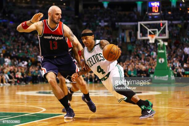 Isaiah Thomas of the Boston Celtics drives against Marcin Gortat of the Washington Wizards during the fourth quarter of Game One of the Eastern...