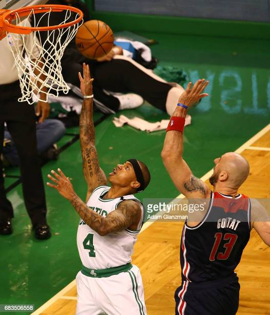 Isaiah Thomas of the Boston Celtics drives against Marcin Gortat of the Washington Wizards during Game Seven of the NBA Eastern Conference SemiFinals...