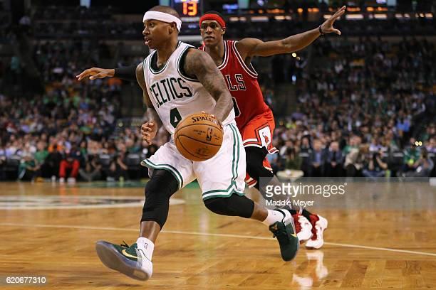 Isaiah Thomas of the Boston Celtics drives against Rajon Rondo of the Chicago Bulls during the third quarter at TD Garden on November 2 2016 in...