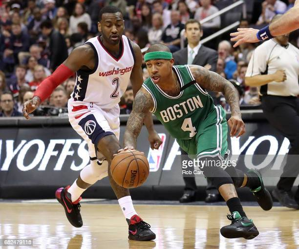Isaiah Thomas of the Boston Celtics drives past John Wall of the Washington Wizards during Game Six of the NBA Eastern Conference SemiFinals at...
