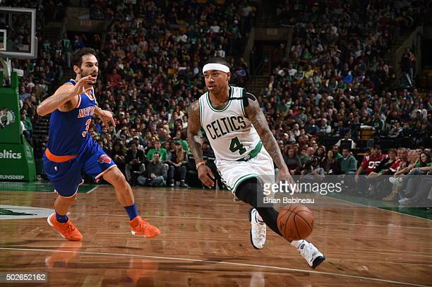 Isaiah Thomas of the Boston Celtics drives to the basket against Jose Calderon of the New York Knicks on December 27 2015 at the TD Garden in Boston...