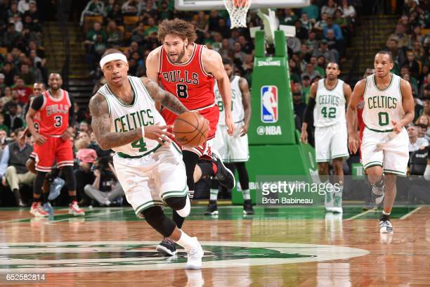 Isaiah Thomas of the Boston Celtics drives to the basket against Robin Lopez of the Chicago Bulls during the game on March 12 2017 at the TD Garden...