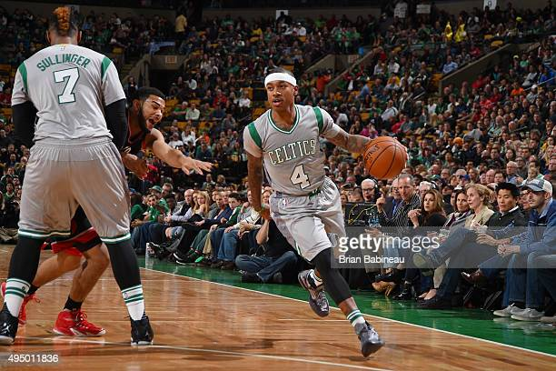 Isaiah Thomas of the Boston Celtics drives to the basket against the Toronto Raptors during the game on October 30 2015 at the TD Garden in Boston...