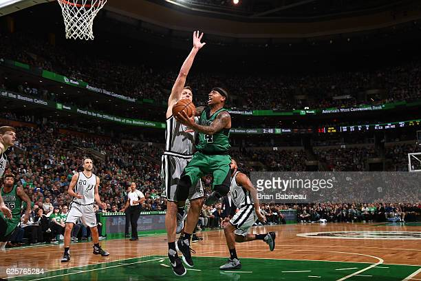 Isaiah Thomas of the Boston Celtics drives to the basket against the San Antonio Spurs on November 25 2016 at the TD Garden in Boston Massachusetts...