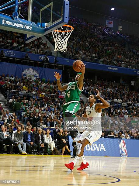 Isaiah Thomas of the Boston Celtics drives to the basket against Trey Thomas of Real Madrid as part of the 2015 Global Games on October 8 2015 at the...