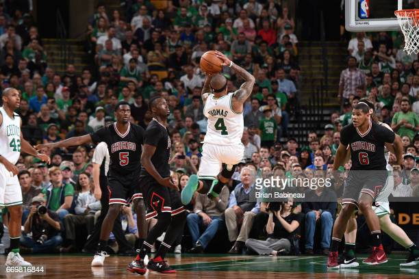 Isaiah Thomas of the Boston Celtics drives to the basket and shoots the ball during the Eastern Conference Quarterfinals game against the Chicago...