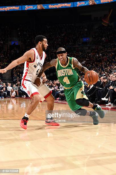 Isaiah Thomas of the Boston Celtics drives to the basket during the game against Cory Joseph of the Toronto Raptors on March 18 2016 at the Air...