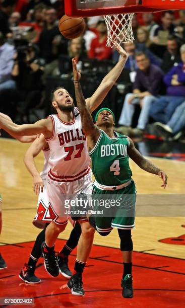 Isaiah Thomas of the Boston Celtics drives to the basket past Joffrey Lauvergne of the Chicago Bulls during Game Four of the Eastern Conference...