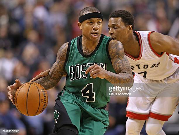Isaiah Thomas of the Boston Celtics goes around Kyle Lowry of the Toronto Raptors during an NBA game at the Air Canada Centre on January 20 2016 in...