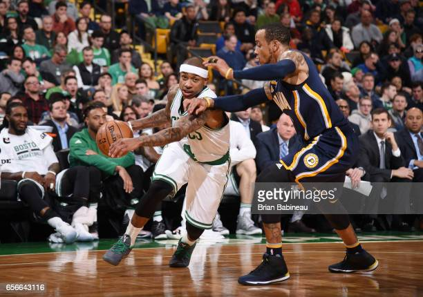 Isaiah Thomas of the Boston Celtics handles the ball against Monta Ellis of the Indiana Pacers during the game on March 22 2017 at the TD Garden in...